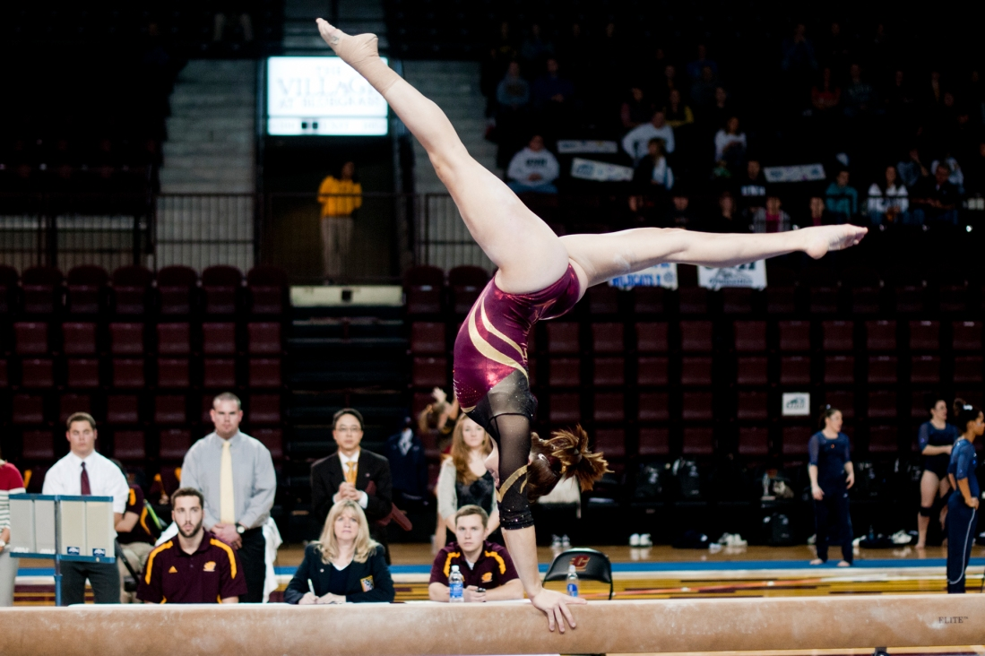Sophomore all-around Taylor Noonan performs on the beam Friday during their meet against University of New Hampshire at McGuirk Arena. Noonan scored a 9.800 for her routine.
