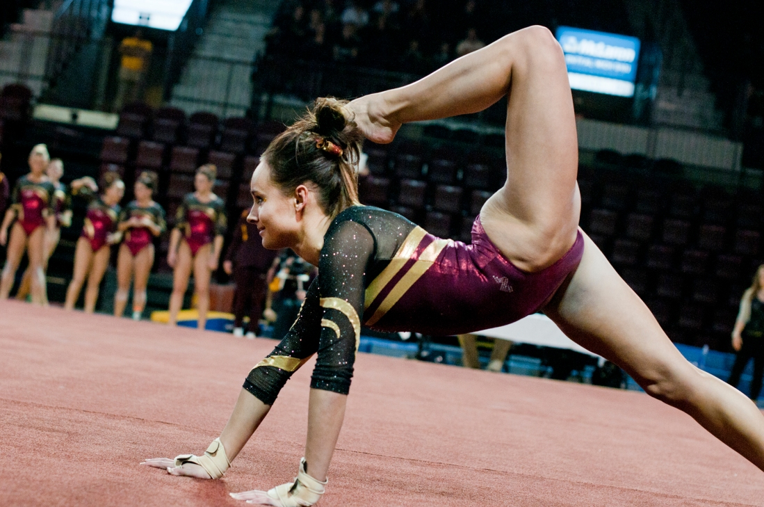 Sophomore all-around Halle Moraw performs her routine on the floor, scoring a 9.800 during their meet against University of New Hampshire on Friday at McGuirk Arena.