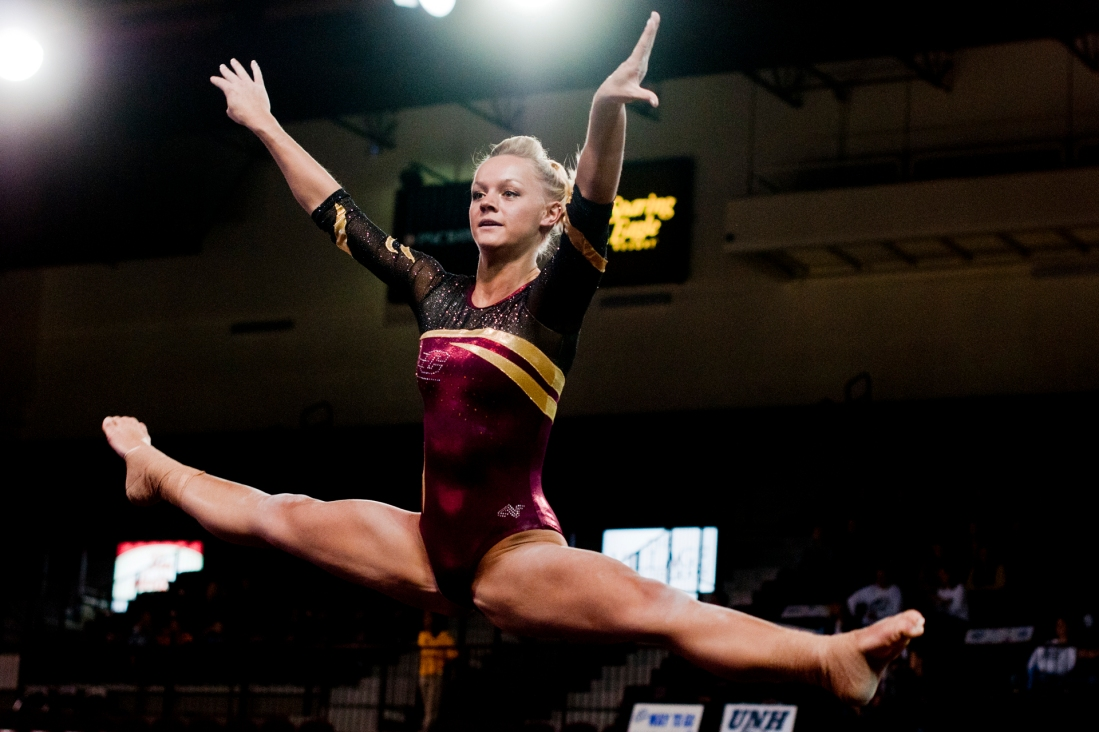 Freshman all-around Kirsten Petzold performs on the beam Friday during their meet against University of New Hampshire at McGuirk Arena. Petzold scored a 9.560 for her routine.